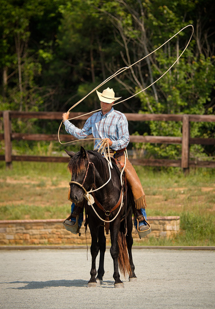 Richard Schouten training DEM Cari�o with rope work in the arena Don E Mor lusitano horse farm